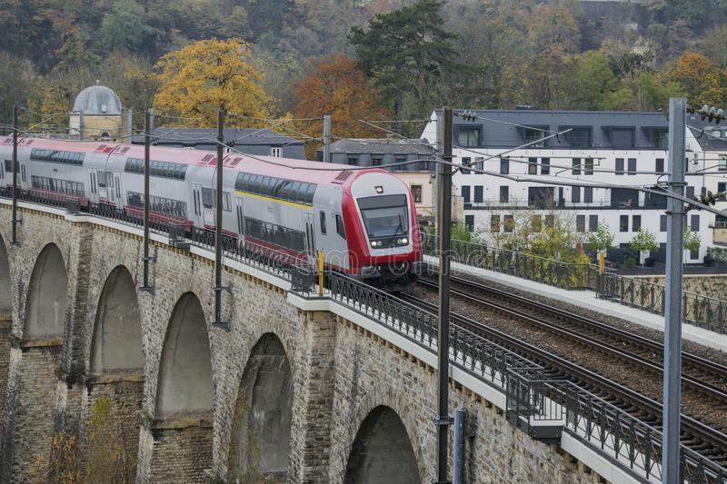 Detail of electrical railroad in Luxembourg city with rails, contact lines and viaduct structures. In dark autumn day illustrating urban transport concept stock photos