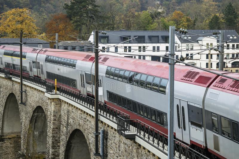 Detail of electrical railroad in Luxembourg city with rails, contact lines and viaduct structures. Detail of electrical railroad in Luxembourg city with train stock photos