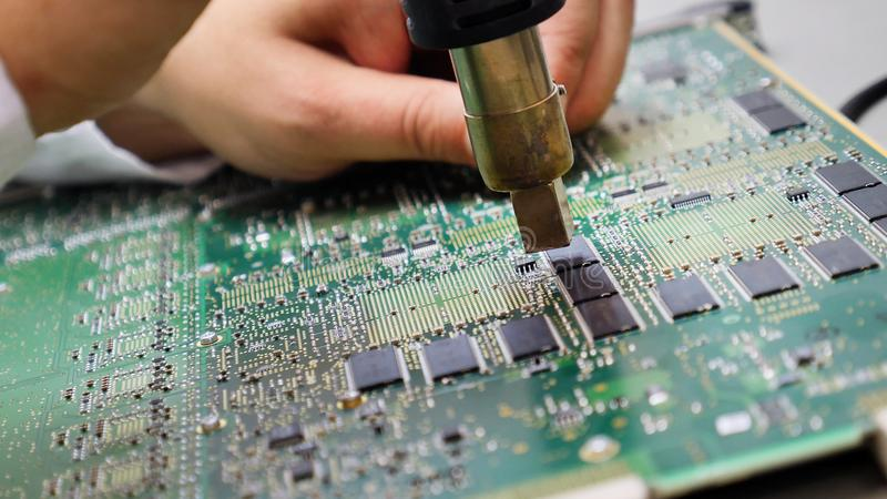 Electronic printed circuit board with many electrical components stock image