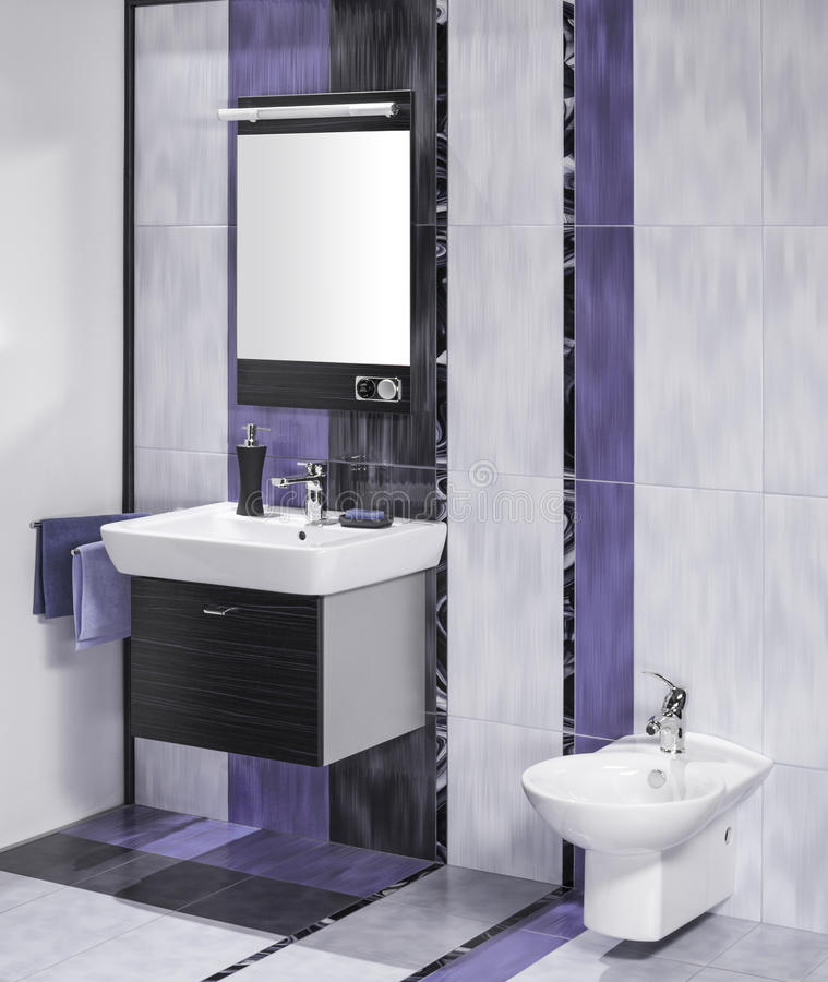 Detail of an elegant bathroom interior. With miror and sink with accessories royalty free stock images