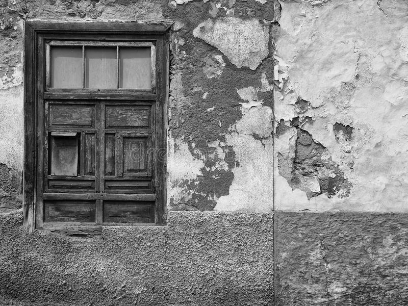 Detail of empty derelict small house with decaying bricks stock images