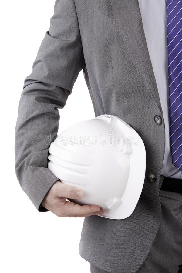 Detail of an engineer holding an helmet royalty free stock photography