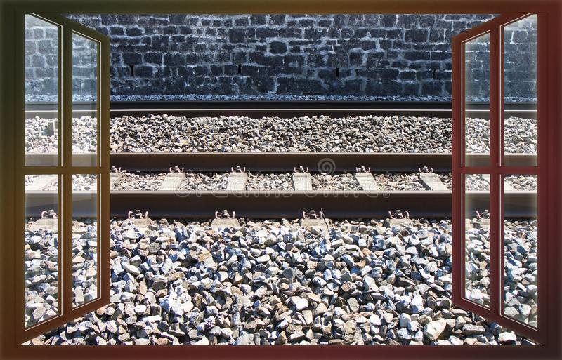 Detail of an european railway with metal train tracks over a roadbed stones - concept image iew from the window royalty free stock photos