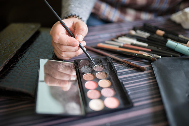 Detail of an eyeshadows palette with hand royalty free stock images