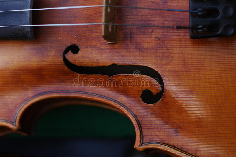 Detail on f-hole and strings of the violin. Moravian cymbalo band royalty free stock images