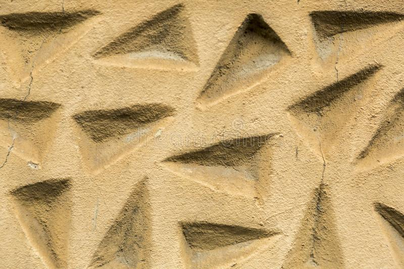 Detail of the ancient facade. Detail of the facade at the ancient house composed of triangles royalty free stock images