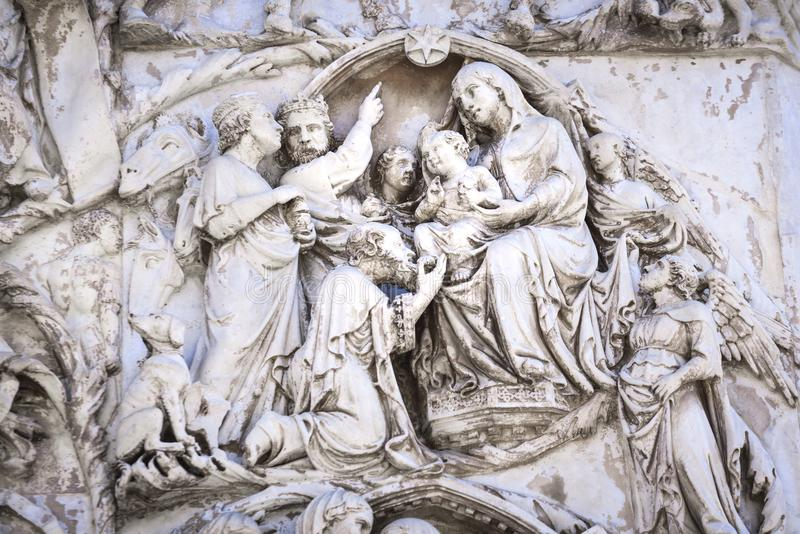 Detail of the facade of the Duomo of Orvieto, Italy. Marble bas-relief representing episodes of the bible. Adoration of the Magi stock images