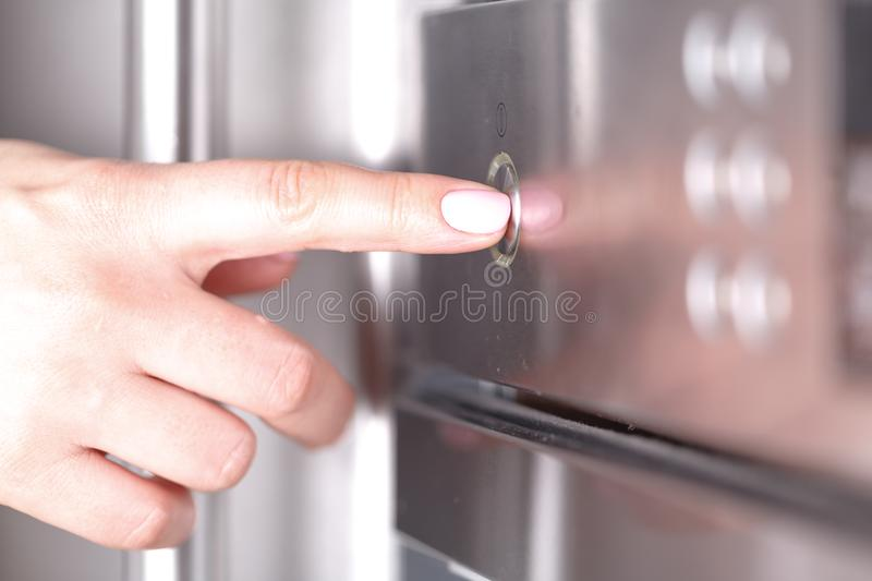 Detail of female hand while using the microwave royalty free stock images