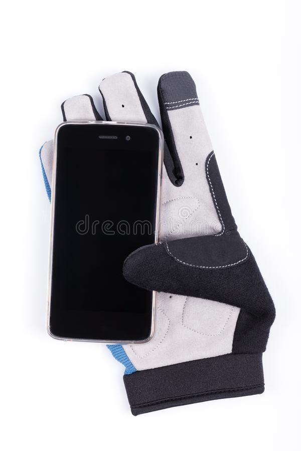 Detail of the finger touch pad of a cycling glove to handle the smartphone royalty free stock photos