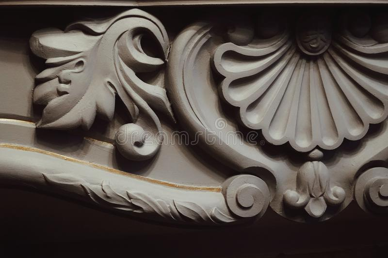 Detail fireplace fretwork gray color luxury textured close-up. Fireplace fretwork gray color luxury textured detail architecture art stock image