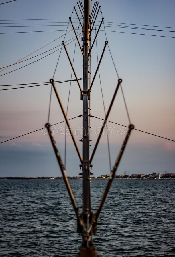 Detail of a fishing scale, a reinforced pole where one end of the net is tied, on the other side another pole.  royalty free stock photo