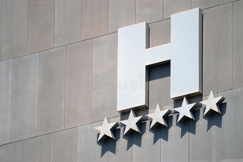 Detail of a five stars luxury hotel facade. Day time royalty free stock photos
