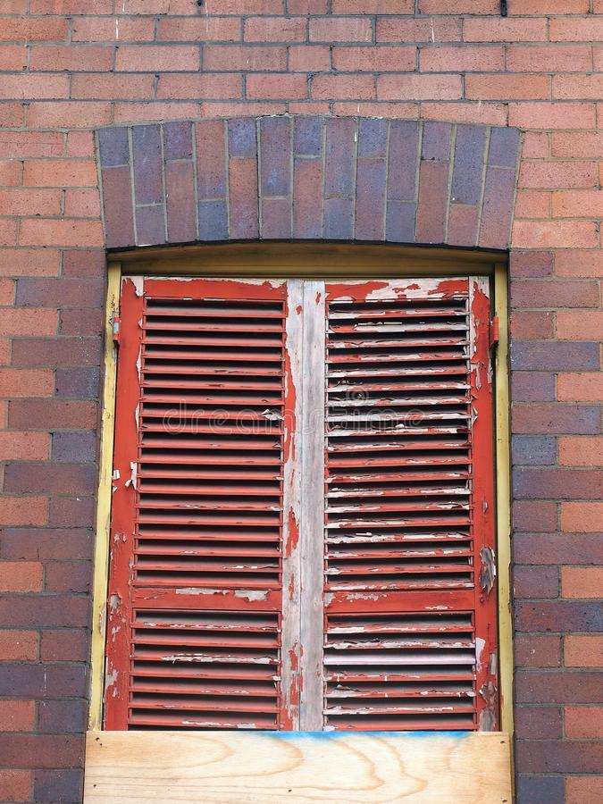 Flaking Red paint on Wooden Window Shutters, Sydney, Australia royalty free stock image