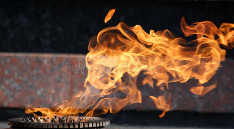 Detail of the flame of eternal fire stock photos