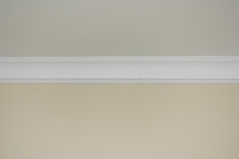 Detail of a flat ceiling skirting. Interior of an empty room royalty free stock image