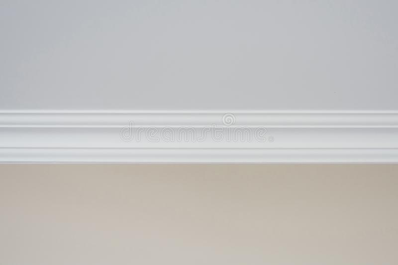 Detail of a flat ceiling skirting, ceiling moldings in the interior.  stock photography