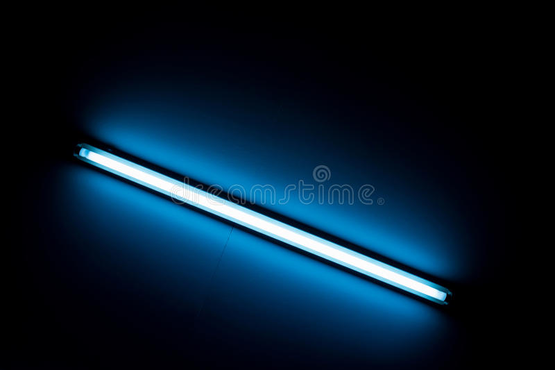 Detail of a fluorescent light tube. Mounted on a wall stock photography