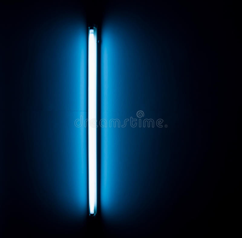 Detail of a fluorescent light tube. Mounted on a wall royalty free stock images
