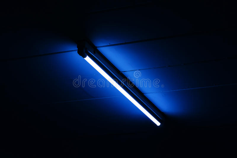 Detail of a fluorescent light tube mounted on a wall. With copy space for any design royalty free stock photography