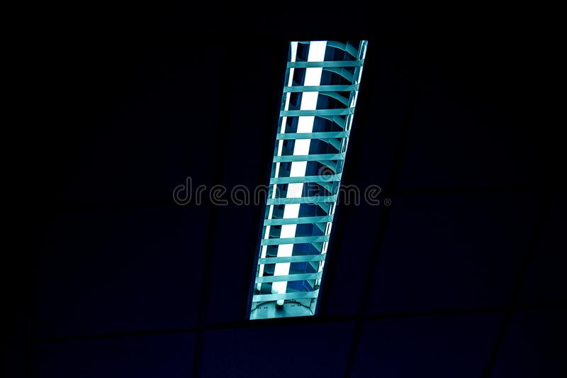 Detail of a fluorescent tube mounted on a wall, false green colo royalty free stock images