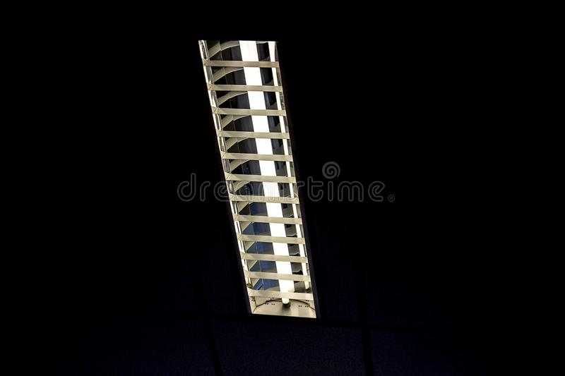 Detail of a fluorescent tube mounted on a wall, false green colo royalty free stock image