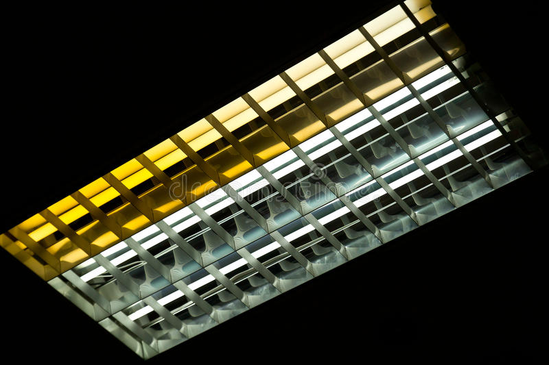 Detail of a fluorescent tube mounted on a wall stock photos