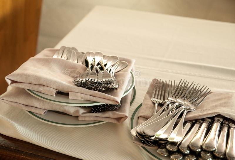 Detail of forks and napkins stacked on a table. royalty free stock photos