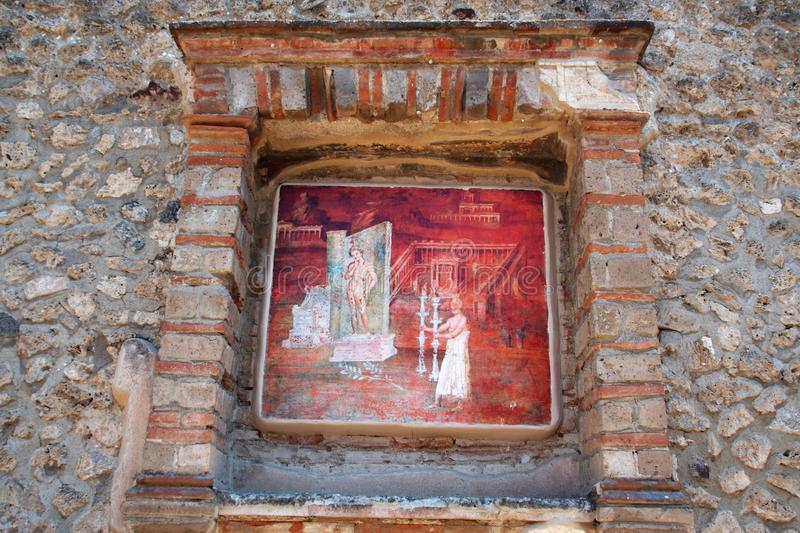 Detail of a fresco in temple of Iside in Pompei archeological site. AT POMPEI - ON 06/22/ 2017 - Detail of a fresco on the wall of temple of Iside of ancient stock image