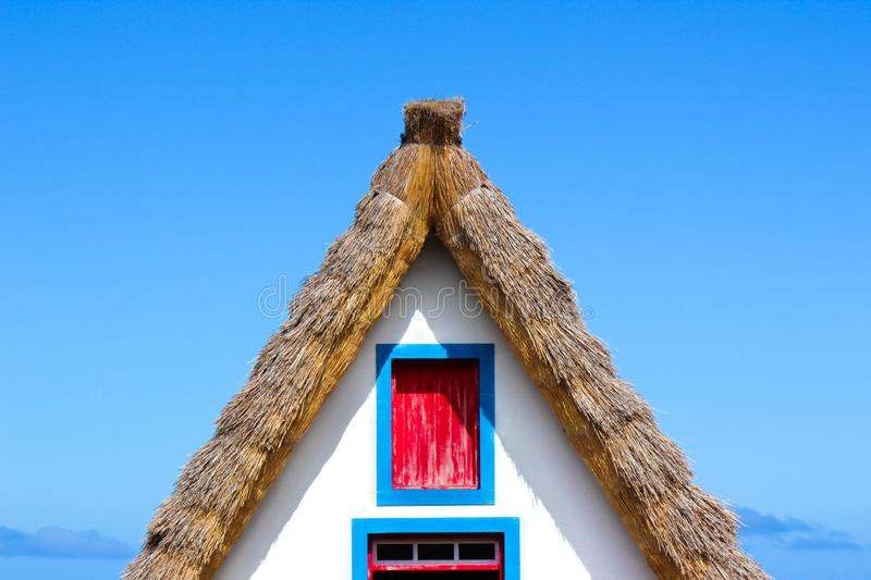 Detail of the front side facade of the traditional house in Santana, Madeira Island, Portugal. Typical thatched roof, colorful royalty free stock images