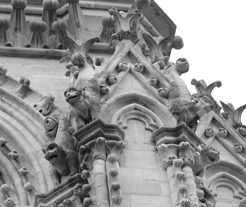 Detail of gargoyle of Basilica of Notre Dame in Paris France. Before the Fire in black and white effect stock image