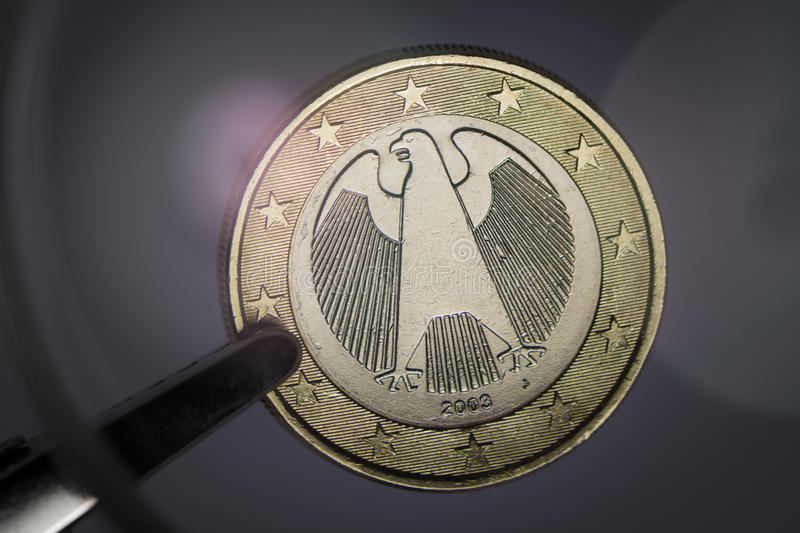 Detail of a German Euro. Close-up of a german euro under magnifying glass stock photography