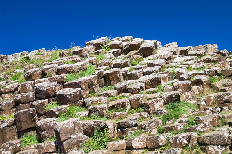 Detail of Giant`s Causeway rock formation against a blue sky royalty free stock photography