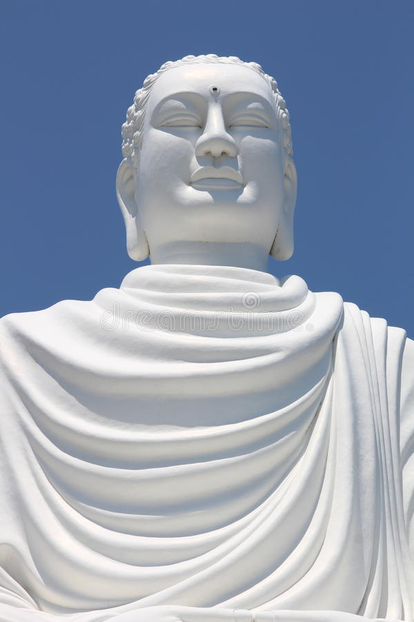 Detail of giant white sitting Buddha statue at Hai Duc Pagoda near Long Son Pagoda, Nha Trang Vietnam royalty free stock images