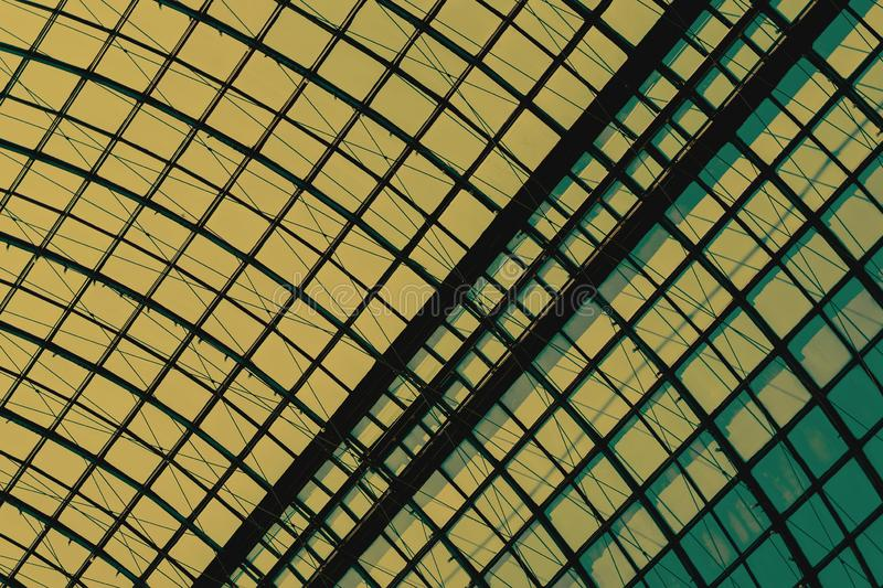 Detail of a glass dome with a metal frame close-up, armature. Graphic texture for a modern background. Detail of a glass dome with a metal frame close-up, yellow royalty free stock photography