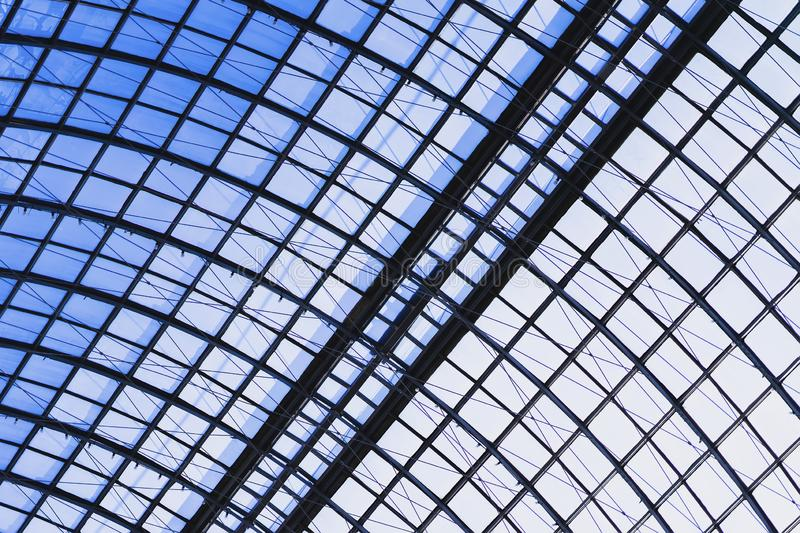 Detail of a glass dome with a metal frame close-up, armature. Graphic texture for a modern background. Detail of a glass dome with a metal frame close-up, blue royalty free stock photo
