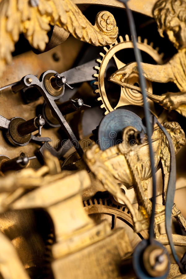 Detail of gold historic clock, clockwork stock image
