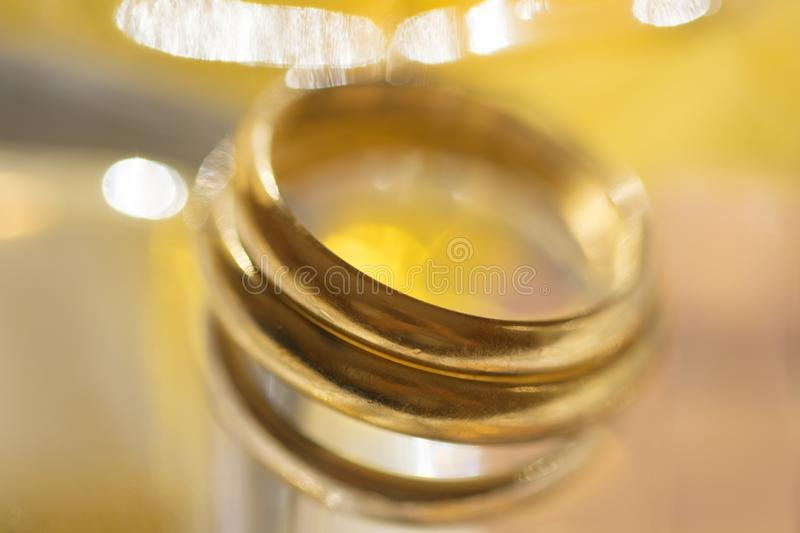 Detail of gold wedding ring stock images