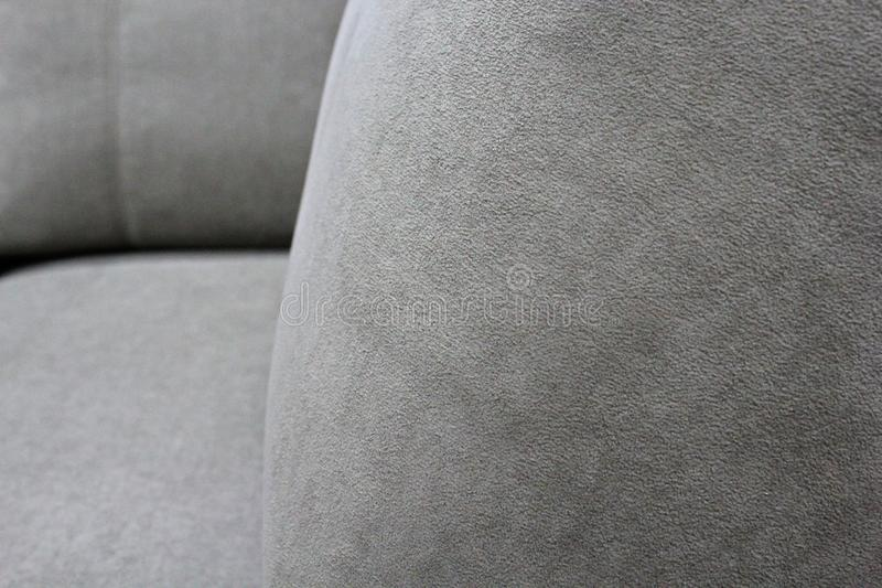 Detail of gray sofa in velour. Macro foto. For backgraund stock photography