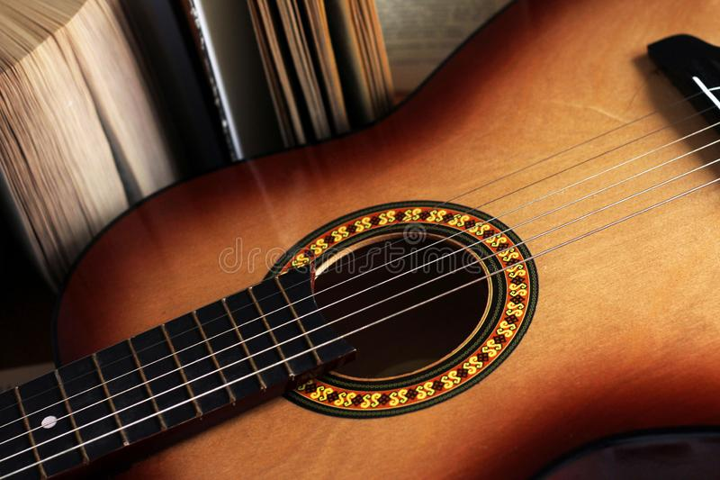 Detail of Guitar and old book royalty free stock images