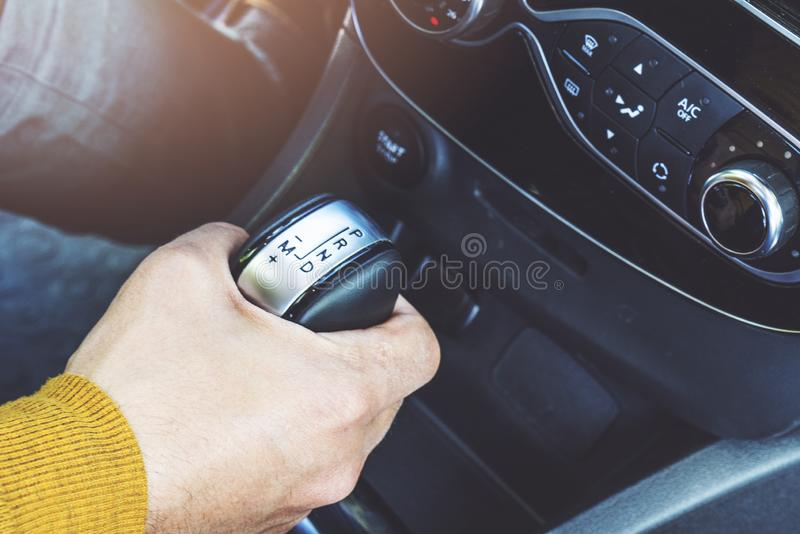 Detail of Hand in gear shift. Car inside, still life stock image
