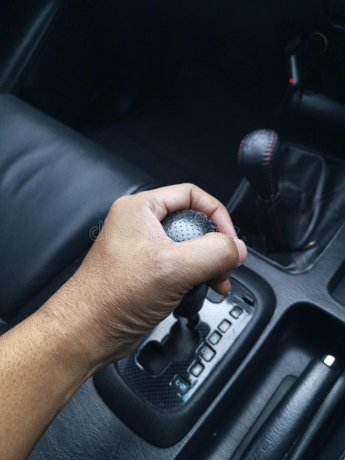 Detail of Hand in gear shift. For design royalty free stock photo