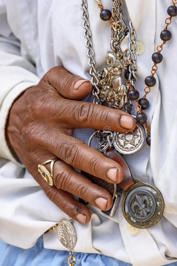 Detail of hands holding religious symbols. During a popular festival in Brazil in honor of Saint George royalty free stock image