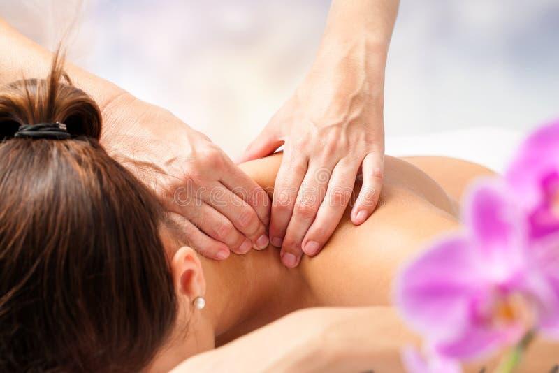 Detail of hands massaging female neck. stock photos