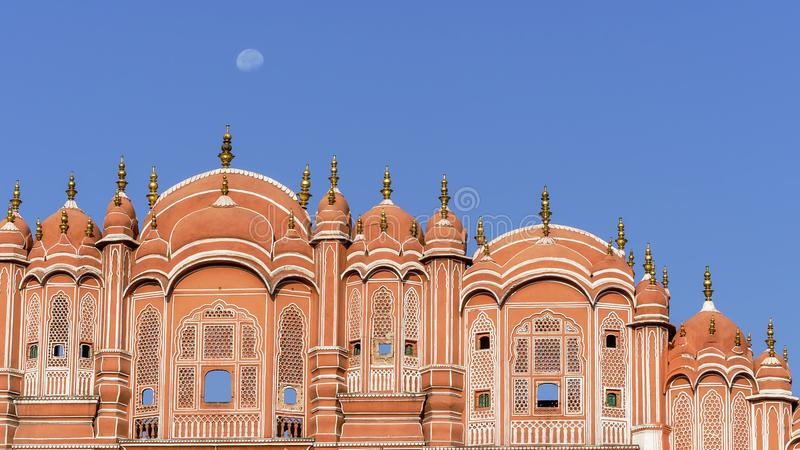 Detail of the Hawa Mahal, Palace of Winds of Jaipur and the moon, Rajasthan, India royalty free stock photos