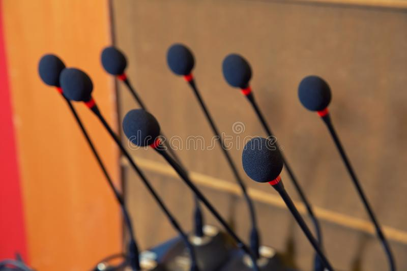Detail of a head of a microphone on a speaker desk on a konference. Concept of speaking before audience on a corporate event. royalty free stock images