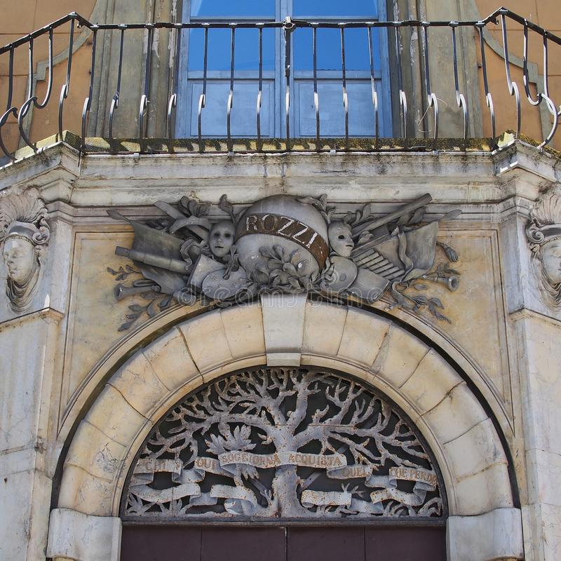 Heraldic Sculptures, Siena Apartment Building. Detail of heraldic bas relief sculptures on an historic traditional faded brown stucco apartment building in Old royalty free stock photos