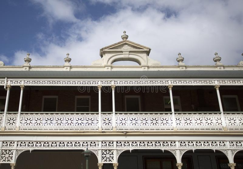 Heritage Listed 19th Century Hotel. Detail of the heritage listed Hotel built in 1889 and ornamented with cast-iron friezework, bullnose awnings and parapets royalty free stock images