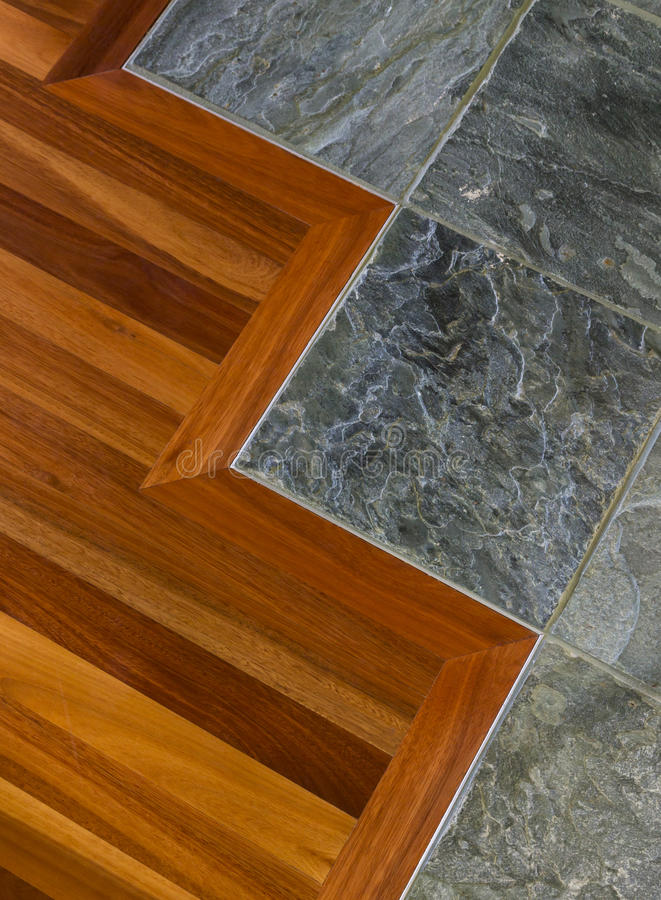 Detail of high quality wood and stone tile floor in contemporary upscale home interior stock image