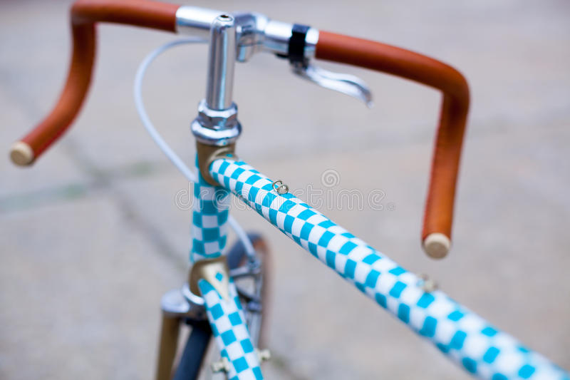 Detail of hipster bike. Photo with detail of hipster bike painted with squares pattern stock photography