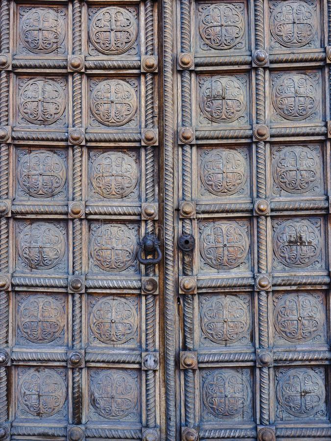 Detail of Heavy Carved Wooden Panel Doors, Alexander Nevsky Cathedral, Sofia, Bulgaria. Detail of historic old carved wood panel external doors, Saint Alexander stock images